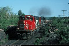 Most of my time spent in the Sudbury area was on CP, but on occasion the CP would be quiet for a few hours and I would then move over to Capreol to try my luck on CN. Here on one of those Capreol trips I lucked into CN 9594, 2022 heading a work extra of side dumps out to a gravel pit on the line to Toronto.