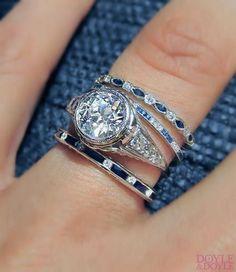 Stack 'em up! Love the classic combination of diamond and sapphire bands with an Art Deco engagement ring. Click to see more eternity bands.