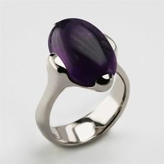 Bardot ring....named after the iconic French actress Brigitte Bardot, much admired by men and women for her luscious lips and sexy curves. This ring has that same round seductiveness, is fabulous to wear and smooth and sleek to touch. All the stones for this ring are hand-cut, Bardot herself would expect nothing less. This design can be made in a variety of solid precious metal and stones options including silver and gold. Use the drop down menus to make your selection.