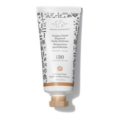 Drunk Elephant Umbra Tinte Physical Daily Defence SPF 30 is a skin-nurturing tinted lotion formulated with mineral-based UVA/UVB protection. Raspberry Seed Oil, Drunk Elephant, Moisturizer With Spf, Natural Glow, Sunscreen, Physics, Lotion, At Least, Fragrance