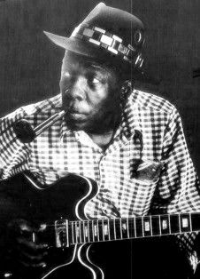 John Lee Hooker. Hooker's guitar playing is closely aligned with piano boogie-woogie. He would play the walking bass pattern with his thumb, stopping to emphasize the end of a line with a series of trills, done by rapid hammer-ons and pull-offs. (Wikipedia)