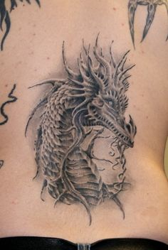 A Western dragon takes form in this fantasy tattoo by Robert Litcan. See more tattoos on rattatattoo.com