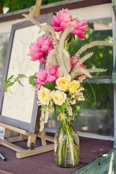 pink and yellow flowers, photo by Blueberry Photography http://ruffledblog.com/healdsburg-garden-party-wedding #weddingflowers #floralarrangements