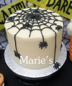 Halloween dessert table  Cake by Maries I like how all the spiders are in different spots...