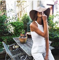 All white with cute taupe sun hat.