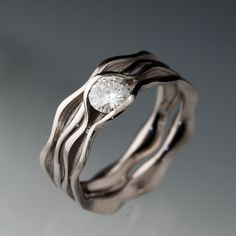 Love this design, it is simple but beautiful totally my flav ... Moissanite Wave Wedding Ring Bridal Set Engagement Rings  in Silver/Palladium, 5mm round gemstone. $775.00, via Etsy.