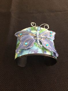 Hey, I found this really awesome Etsy listing at https://www.etsy.com/listing/169927395/floral-butterfly-cuff-bracelet-blue
