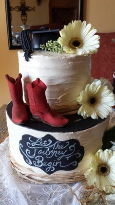 Graduation Cake. Red fondant cowboy boots. Graduation cap. Fondant chalkboard plaque.  Made this for my friends daughter.