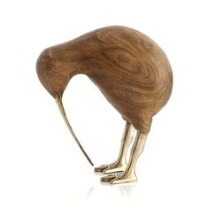 Combining richly grained mango wood and sparkling brass, this charming kiwi bird draws attention whether standing or sitting. Due to its handcrafted nature, each bird will vary slightly.