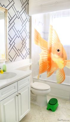 Stenciled kids bathroom - white walls painted with Benjamin Moore Hale Navy and goldfish shower curtain