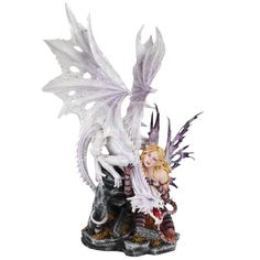 In the Guarding the Horde Dragon and Fairy Statue, this dragon and his fairy companion stand atop a portion of his precious treasure. Description from medievalcollectibles.com. I searched for this on bing.com/images