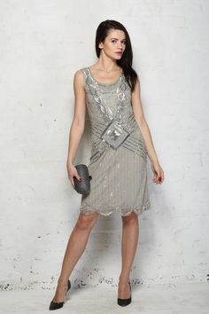 1920s+Flapper+Dress+-+It+is+not+often+that+we+are+truly+bowled+over+by+a+beaded+vintage+dress+but+this+grey+1920s+flapper+dress+has+well+and+truly+knocked+our+socks+off.+The+darling+deco+detailing+in+bold+diamond+design+not+only+stays+true+to+the+era+but+adds+a+tougher+edge+to+this+glamorous+style.+The+cut+of+this+art+deco+evening+dress+remains+super+flattering+with+a+dropped+waist+and+a+skirt+with+fluid+movement+that+moves+freely+when+you+do.+We+haven't+even+got+started+on+the+back+wi...