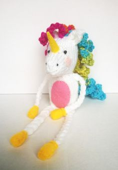 Free Lenny the Unicorn soft toy knitting pattern from www.lianamarcel.co.uk || Lenny The Unicorn After much adoration and interest over my Lenny shelf sitting cuddly buddy on facebook I decided to let you all have this easy knitting pattern to make your own!Lenny is the masco… https://lianamarceldesigns.wordpress.com/2015/10/01/free-lenny-the-unicorn-soft-toy-knitting-pattern-from-www-lianamarcel-co-uk/?utm_campaign=crowdfire&utm_content=crowdfire&utm_medium=social&utm_source=pinterest