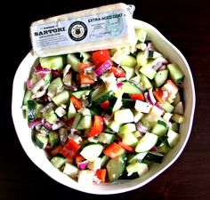 Cucumber Salad with Sartori Extra-Aged Goat Cheese  2 cucumbers 1 red onion 1 red pepper 1 wedge Sartori Extra-Aged Goat Cheese 3 tbsp. Italian dressing Chop cucumbers, red onion and red pepper. Place in bowl. Dice cheese, it will be crumbly. Add to vegetables. Coat with dressing and mix.