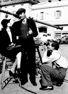 "GLENN FORD (photographing Rita Hayworth on the 1940 set of ""The Lady in Question"")"