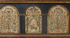 """Pook & Pook. April 25th & 26th 2014. Lot 751 front detail.  Berks County, PA. painted pine dower chest, dated 1776, decorated by the Black Unicorn Artist, the façade with 3 arched panels & potted tulips, with a central panel of a soldier on horseback, 22 1/2"""" h., 44 1/2"""" w. Nice tulip hinges. Blue background probably enhanced. Feet replaced. Estimated: $10K - $15K."""