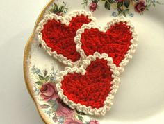 This listing is for 3 delicate crochet hearts each 2.5 x 2.5 made with cotton yarn.    Red crochet hearts edged with cream.    Perfect to embellish