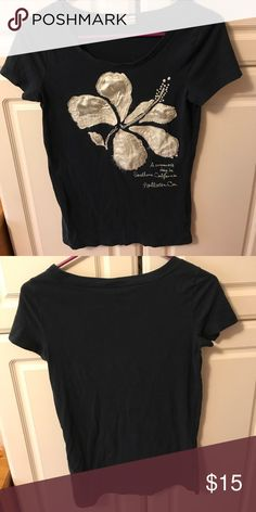 346ec115fa7 Navy Hollister shirt Cute Navy Hollister shirt with white cream flower.  Slightly worn