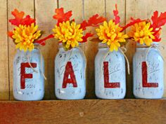 Set of 4 quart sized mason jars that have been hand painted and distressed to spell out the word FALL. All jars have a protective clear coat and