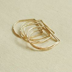 - One Golden Square Top Thread of Gold - Yellow or Rose - Tiny Hammered Stacking Ring - Delicate Jewelry - First Knuckle Ring. $9.75, via Etsy.