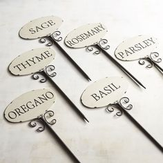 Add an elegant and informative touch to your gardening. Our set of six iron herb stakes gives clarity to the garden so there's no mistaking the oregano for the basil. Perfect for indoor and outdoor use—and nice for potted gardens, too. Herb Markers, Plant Markers, Garden Markers, Garden Stakes, Garden Planters, Herb Garden, Garden Junk, Garden Labels, By Any Means Necessary