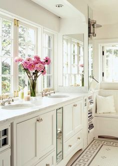 I love the windows, instead of a traditional mirror... not sure I would ever remember to brush my hair without the reminder, but the light is amazing! #bathrooms #windows