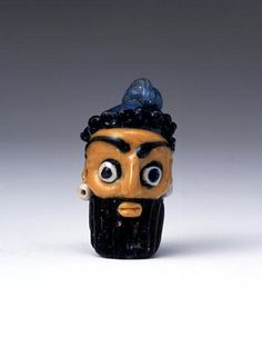 Phoenician Glass Pendant in the Form of a Bearded Head 5th cent.BCE