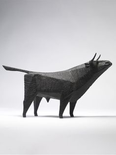 """Standing Bull"" by Terence Coventry. [Image #9 of Week: Sept 23th - 27th] This bronze sculpture is really cool because of the use of shapes to make the figure and the overall simplicity. I also wonder what the bull is looking at..."