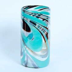 Turquoise Brown Vase: A celebration of colour and hand blown in Mexico, this vase is versatile and can also be used as a candleholder.