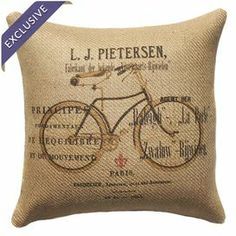 """Burlap pillow with a bike motif and typographic details. Handmade in the USA.   Product: PillowConstruction Material: Burlap coverColor: Brown, black and beigeFeatures:  Handmade by TheWatsonShopZipper enclosureMade in the USA Insert includedDimensions: 16"""" x 16""""Cleaning and Care: Spot clean"""