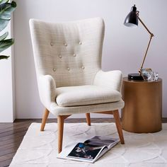 Inspired by streamlined Danish style, the Niels Wing Chair's curved lines are a modern take on the wingback. Button tufting gives it a dressed up look.