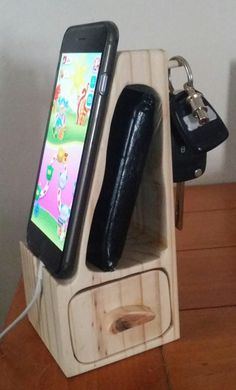 Reclaimed 4x4 bandsaw phone docking station.                                                                                                                                                                                 More