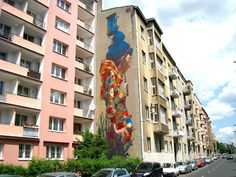 Sainer from Etam Crew has just completed a massive and stunning new mural for the Fundacja Urban Forms festival on the streets of Lodz, Poland.  With his bold and vibrant style that was already seen for his last year's piece(covered), Sainer painted this mural over the course of a week.  If you stop by Lodz, this one can be seen Uniwersytecka 12, Lodz.