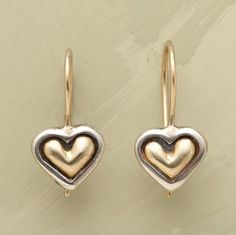 "WEDDING VOW EARRINGS -- Sterling silver represents her heart, 14kt gold symbolizes his. Joined as one, they cling to 14kt gold locking French wires. 3/4""L."