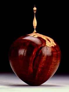 """Recent Turnings by Jim Syvertsen. Black Mulga with Desert Ironwood Finial.   2-3/4"""" x 4-3/4"""". Syvertsen is a US Naval Academy grad who, after retiring from the Navy, began a second career as an artist. """"By the winter of 2004/2005... I started AUSTRALIANBURLS.com and have worked very hard with suppliers to find the most interesting and exciting burls and hardwoods. In parallel, I've worked hard to improve my craft and participated in craft shows from New York to Florida."""""""