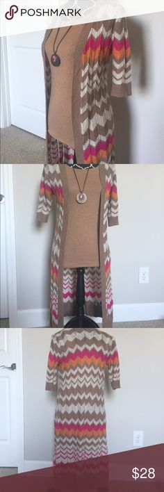 The Limited Chevron Print Duster This is in perfect preloved condition. Open in front and long, short sleeve, thin enough to wear on a nice fall day! Style suggestion shown, but listing is for sweater only. 100% acrylic. The Limited Sweaters