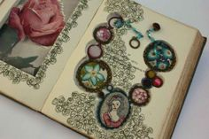 altered book with inlaid altered necklace