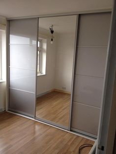 Fitted made to measure sliding wardrobe with silver mirror & sparkly silver split doors. Fitted by experts and guaranteed for 10 years!  Below is a link to our online calculator to see how much your bespoke made to measure wardrobe will cost http://www.foxwardrobes.co.uk/instant-online-estimator/