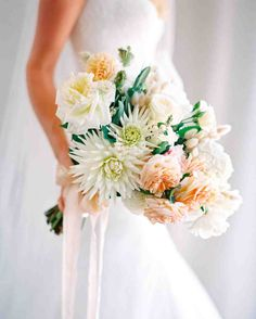 Playful Pastel Bridal Bouquet | Martha Stewart Weddings - In this stunner by Natural Art Flowers, cactus dahlias nestle alonside white, peach, and pink roses, while pussy willow and milk berries provide a pretty accent.