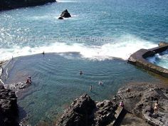 ~natural swimming pools which are ocean rock pools by the giant cliffs of Los Gigantes on Tenerife Spain~