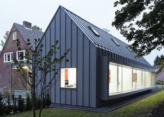 Dutch studio Shift has converted a suburban house in the south of the Netherlands and turned it into a dental surgery with a new zinc-clad wing. Zinc Cladding, House Cladding, Exterior Cladding, Wall Cladding, Architecture Details, Modern Architecture, Barndominium Floor Plans, Suburban House, Shed Homes