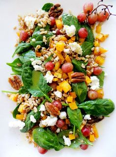 Here's a hearty winter salad that doesn't include any pale wimpy tomatoes, it's filled with delicious and nutty tasting farro, butternut squash, fresh spinach, honey goat cheese, pecans for crunch and my new favorite ingredient, roasted grapes!