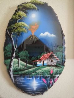 """Hand painted and glazed Costa Rican landscape in aaALLHouseSale_worldwideitems' Garage Sale in Kenosha , WI for $20. beautiful hand painted glossy picture of a volcano and home. Typical Costa Rica. Painted on a 3/4"""" slice of tree trunk."""