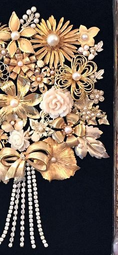 This golden bouquet made of entirely vintage/estate sale jewelry is truly an elegant art piece. It is in a vintage/antique re-purposed heavy & ornate frame measuring approx. 15x20 with an opening of approx. 8.5x11. I found this frame in an antique store and is made of plaster.