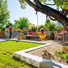 By turning a sloped plot into a modern play den, a designer created usable family space where none existed before. In this Greenbrae, CA, front yard, the designer placed concrete planters along the sidewalk, and filled them with 'Firebird' phormiums to create friendly screening without totally blocking off the yard. The raised patio is edged with concrete to help level the area and create a flat lawn and distinct spots for the family to dine, entertain, and play.