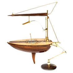 lamp in the shape of a boat,made from an old music instrumen.
