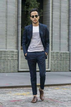 022d0c617c5 with a summer business casual suiting idea with a navy suit white tshirt  with black stripes no show socks brown captoe shoes rayban wayfarers