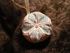 Tutorial: 15-Sided Biscornu ... A biscornu is an oddly shaped, embroidered and stuffed pillow, usually used for ornaments and pincushions. (A Whispered Stitch by Isabel Winterbourne)