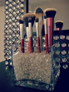 I love the look of this glass storage and beads to store makeup brushes