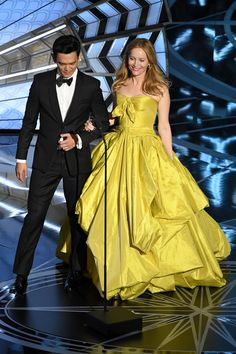 Actors John Cho (L) and Leslie Mann speak onstage during the 89th Annual Academy Awards at Hollywood & Highland Center on February 26, 2017 in Hollywood, California.